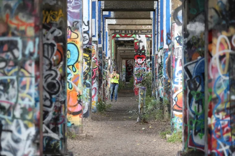 Conrail's Jocelyn Gabrynowicz Hill walks the Port Richmond rail yard. Police say they will crack down on trespassing in the space that is closed to the public.
