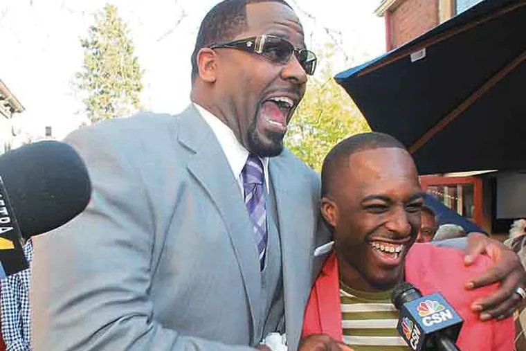 Former NFL player Jeremiah Trotter (left) jokes with The North Star movie co-star Thomas Bartley before they attended the premiere of the film at The County Theater in Doylestown, Pa. on Thursday, May 2, 2013.  Trotter is the lead actor in the locally produced film about a runaway slave.  ( Yong Kim / Staff Photographer )  STROTTER03P