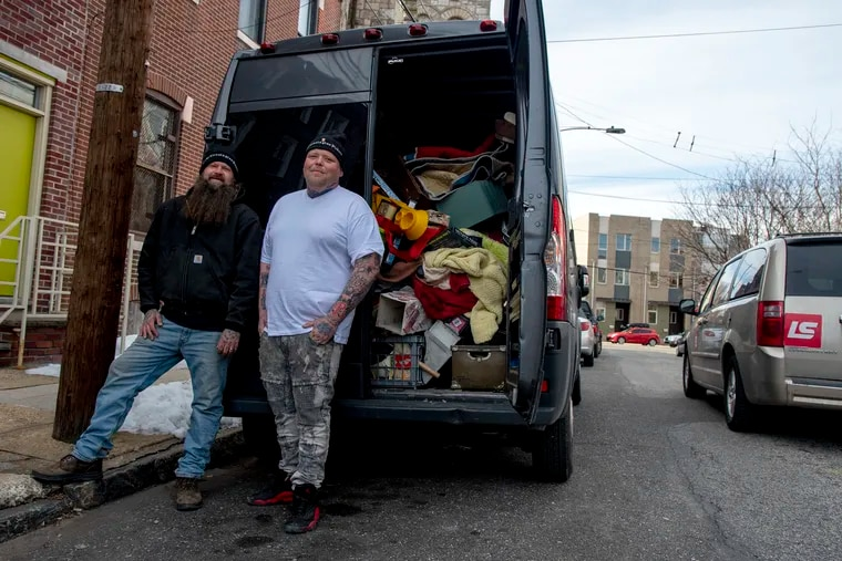 """The Kensington Pickers, Matt Melnick, left, and Robert """"Buddy"""" Stewart, right, are pictured in front of Melnick's van, which is filled to the brim with recent items they've picked."""