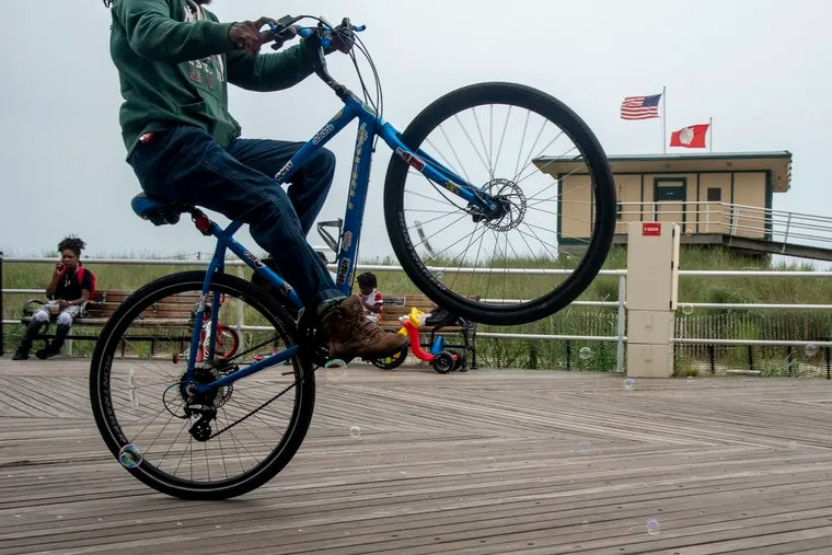 August 9, 2021: Lill Hayes does a wheelie along the Boardwalk in Atlantic City.