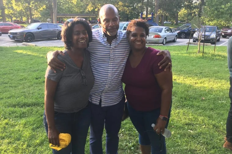 Abby Hasberry (right) with biological siblings Rodney and Toi, who have not yet told all their adoptive family members they have found birth relatives.