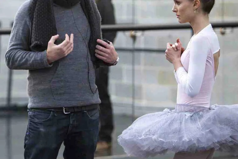 """Director Darren Aronofsky on the set with Natalie Portman, who trained rigorously for months for the part as a ballerina. """"The emotional stuff, for her, was intense as well,"""" he says."""