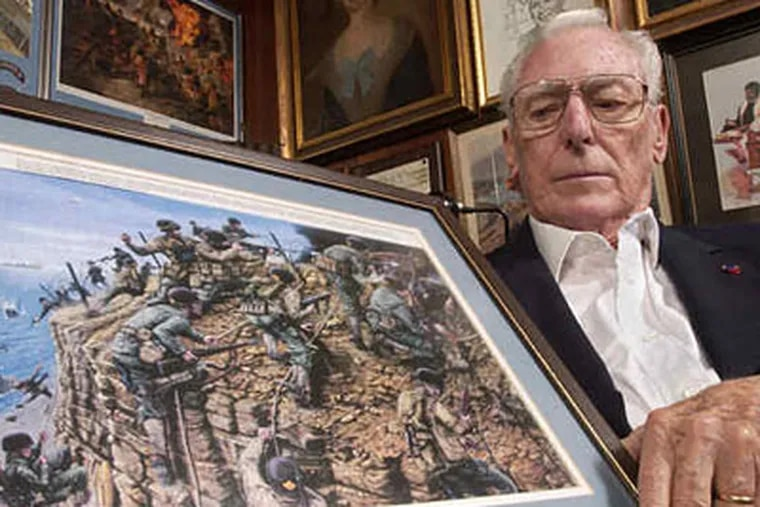 Leonard Lomell, 88 , with a painting depicting him and fellow Rangers scaling the cliffs at Pointe du Hoc, west of Omaha Beach.