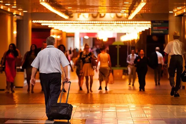 Pedestrians walk through the once-bustling Gallery on Market Street.. MICHAEL PRONZATO / Staff Photographer