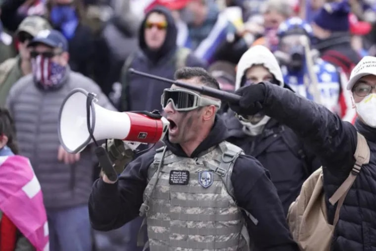 Samuel Lazar, 37, of Ephrata, is pictured shouting to the crowds outside the Capitol in Washington on Jan. 6.
