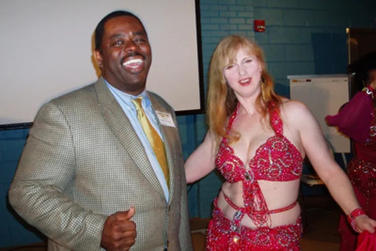 Carl R. Greene, former director of the Philadelphia Housing Authority, posed with a belly dancer at a PHA-sponsored event in 2006.