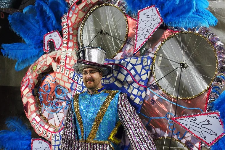 Michael Carwile of Golden Sunrise in his mummer suit, which he worked with Isaiah Zagar on.