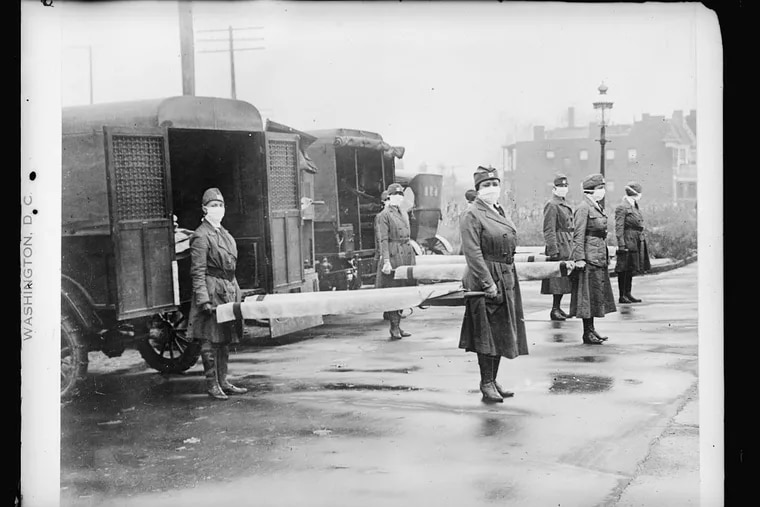 Members of the St. Louis Red Cross Motor Corps on duty on 5 ambulances during the 1918 influenza pandemic.