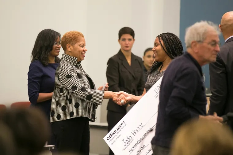 """SRC chair Joyce Wilkerson performs one of her first official acts, congratulating Jada Harris, one of the district's """"senior of the month"""" recipients."""