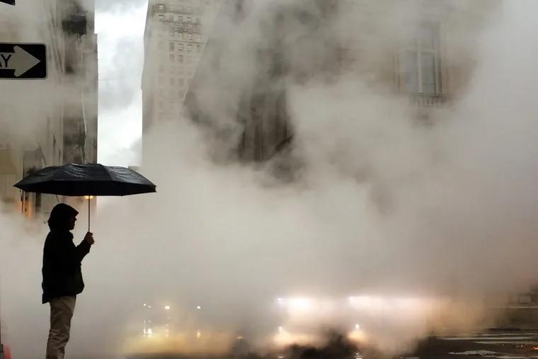 Steam from a Veolia Energy vent in Center City envelops a pedestrian on Sansom Street.