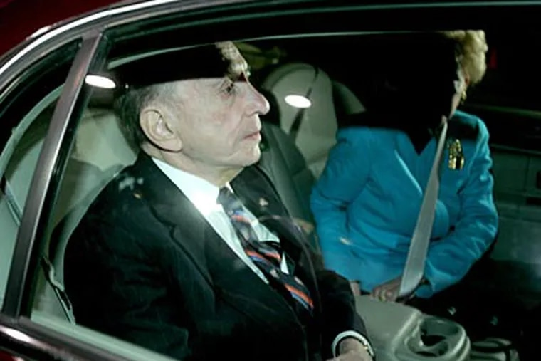 Arlen Specter and his wife Joan leave his campaign's election night headquarters after conceding to Joe Sestak.  (Charles Fox / Staff Photographer)