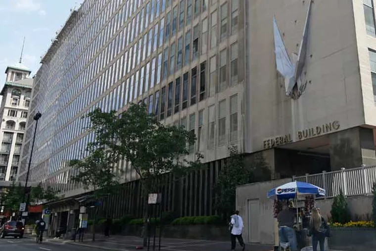 """The John Weld Peck Federal Building, shown Tuesday, May 14, 2013, in Cincinnati, houses the main offices for the Internal Revenue Service in the city. The IRS apologized Friday for what it acknowledged was """"inappropriate"""" targeting of conservative political groups during the 2012 election to see whether they were violating their tax-exempt status. In some cases, the IRS acknowledged, agents inappropriately asked for lists of donors. The agency blamed low-level employees in a Cincinnati office, saying no high-level officials were aware. (AP Photo/Al Behrman)"""