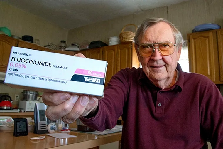 Casimir Janczewski, 74, of Port Richmond, shows the last prescription of generic cream Fluocinonide made by Teva he bought while sitting in his kitchen Nov. 18, 2014. ( CLEM MURRAY / Staff Photographer )