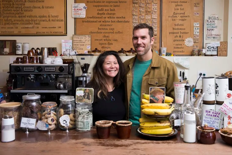 Crystal Stokowski met her husband, Davidson Thomas, after Benna's Cafe owner Nancy Trachtenberg set her mind to getting them together. Stokowski (and Thomas) worked at Benna's for several years; she created the signs seen behind her in this photo.