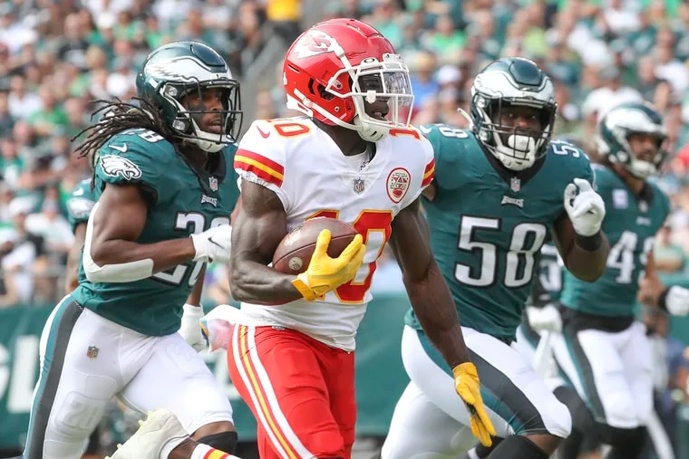 Kansas City Chiefs wide receiver Tyreek Hill (10) rushes the ball past Eagles' defenders Anthony Harris and Genard Avery in the first quarter of a game at Lincoln Financial Field in South Philadelphia on Sunday, Oct. 3, 2021. Kansas City won, 42-30.