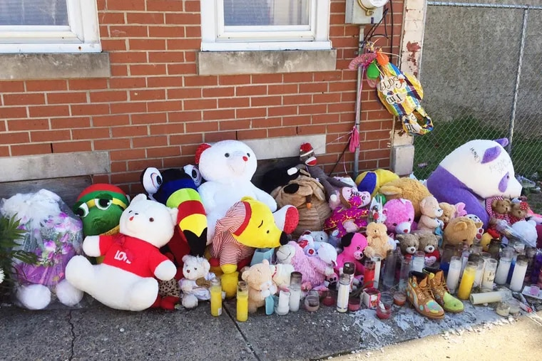 A memorial of stuffed animals, candles and other mementos sits outside the house in Mantua where Jamara Stevens was shot and killed April 5.
