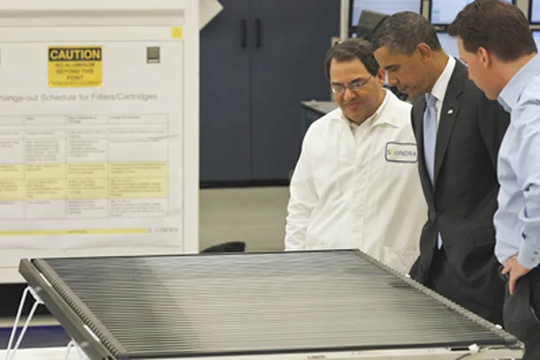 President Obama got a tour of Solyndra last year from executive vice president Ben Bierman (left) and founder Chris Gronet. (Alex Brandon / Associated Press, File)