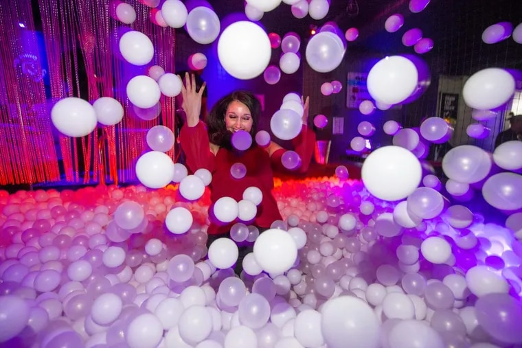 A young woman enjoys herself in the ball pit in the Concourse Dance Bar.