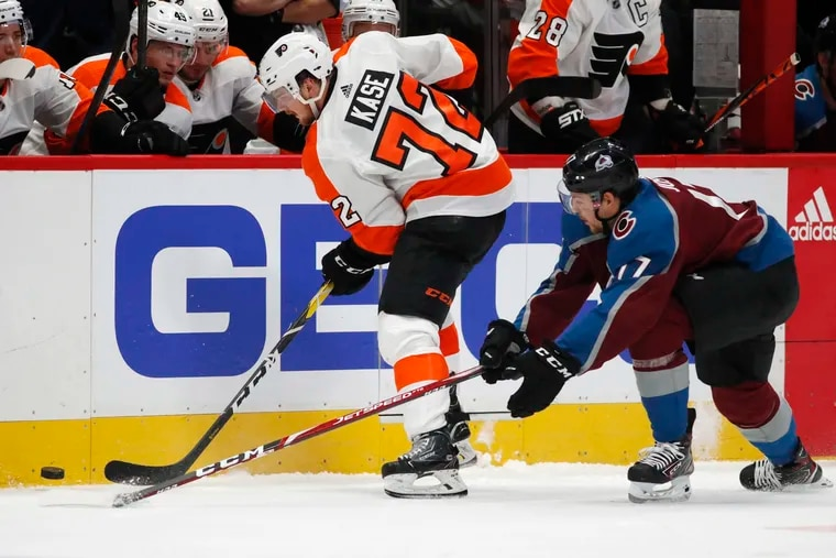 Flyers left winger David Kase, collects the puck along the boards as Colorado's Tyson Jost defends in the first period. Kase made his NHL debut in the game Wednesday.