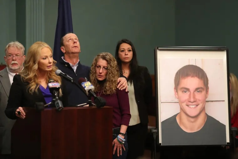 Centre County DA Stacy Parks Miller speaks about the Beta Theta Pi hazing investigation and the charges brought against 18 people last spring. Timothy Piazza'a parents Jim and Evelyn Piazza stand with her in the Centre County Court annex in Bellefonte, Pa., Friday May 5, 2017. ( DAVID SWANSON / Staff Photographer )