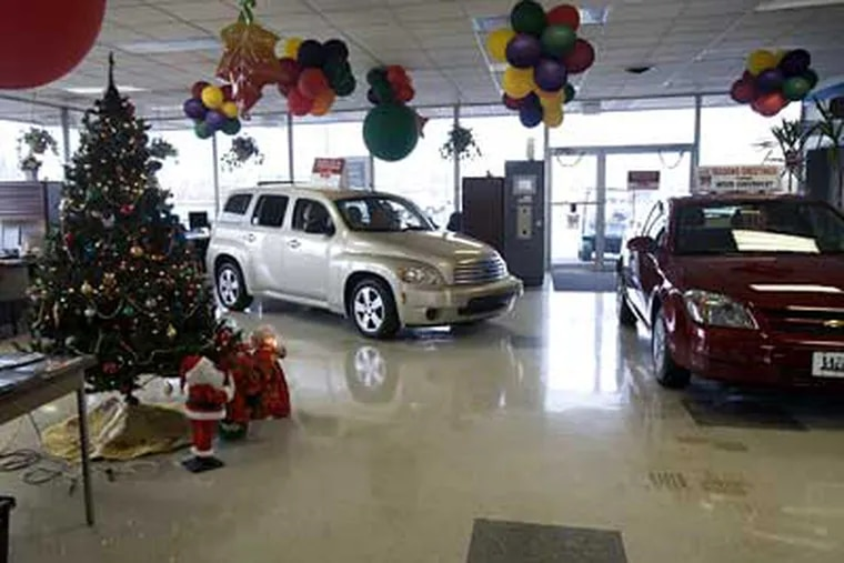 Empty showroom at Weed Chevrolet, the Bristol car dealership that is closing. Some dealers blame the downward spiral of GM and the U.S. auto industry on GMAC's cutoff in Oct. of loans to car buyers. (Ed Hille / Staff Photographer)