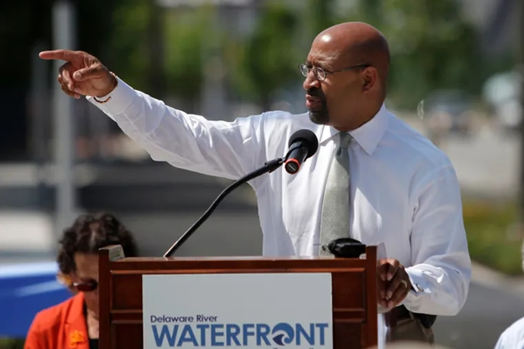 Mayor Nutter gives his remarks at the opening of the Delaware River Trail on Monday morning. The trail is sponsored by the Delaware River Waterfront Corp.