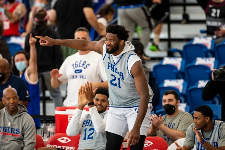 Joel Embiid points to crowd as he was introduced to the fans before the Sixers' scrimmage at Chase Field House in Wilmington, Del., on Saturday, Oct. 9, 2021.
