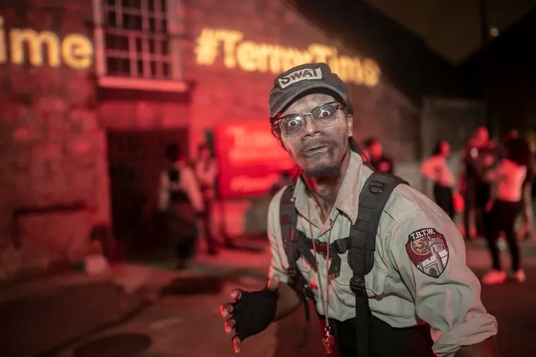 Mohamed Hassan, an actor on the SWAT team, does a choreographed dance at Eastern State Penitentiary. Eastern State Penitentiary acknowledges its Terror Behind The Walls attraction is historically inaccurate.