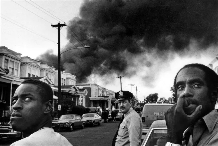 The scene at the corner of 62nd and Larchwood in Philadelphia, in the afternoon following the dropping of bomb on MOVE headquarters, May 13, 1985.