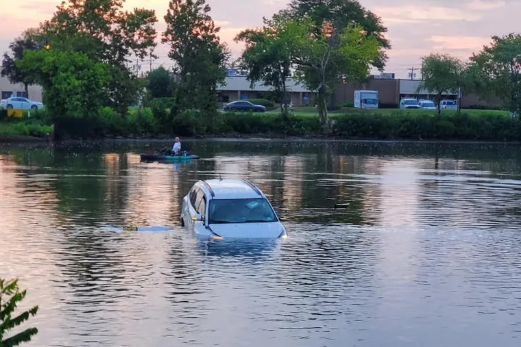 A car that crashed into Cooper River on Saturday morning. Collingswood police officers rescued the man trapped inside the vehicle.