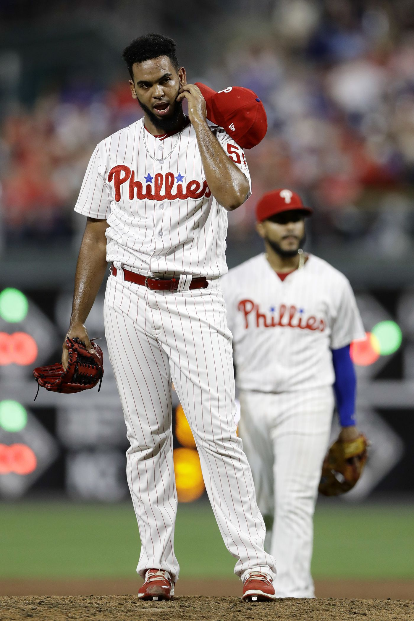 193f275eda2 Reliever Seranthony Dominguez removes his hat and glove before being  removed by manager Gabe Kapler during
