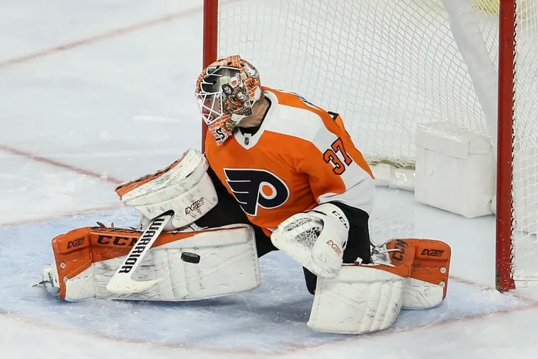 Flyers goalie Brian Elliott stopping the puck against Pittsburgh during the third period at the Wells Fargo Center on Jan. 21. The Flyers blanked the Penguins 3-0.