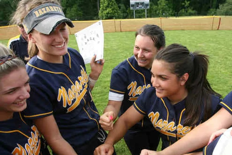 Nazareth Academy players huddle after Cipolloni (right) pitched a one-hitter to beat Villa Maria, 3-0, and win the Athletic Association of Catholic Academies championship on Friday.