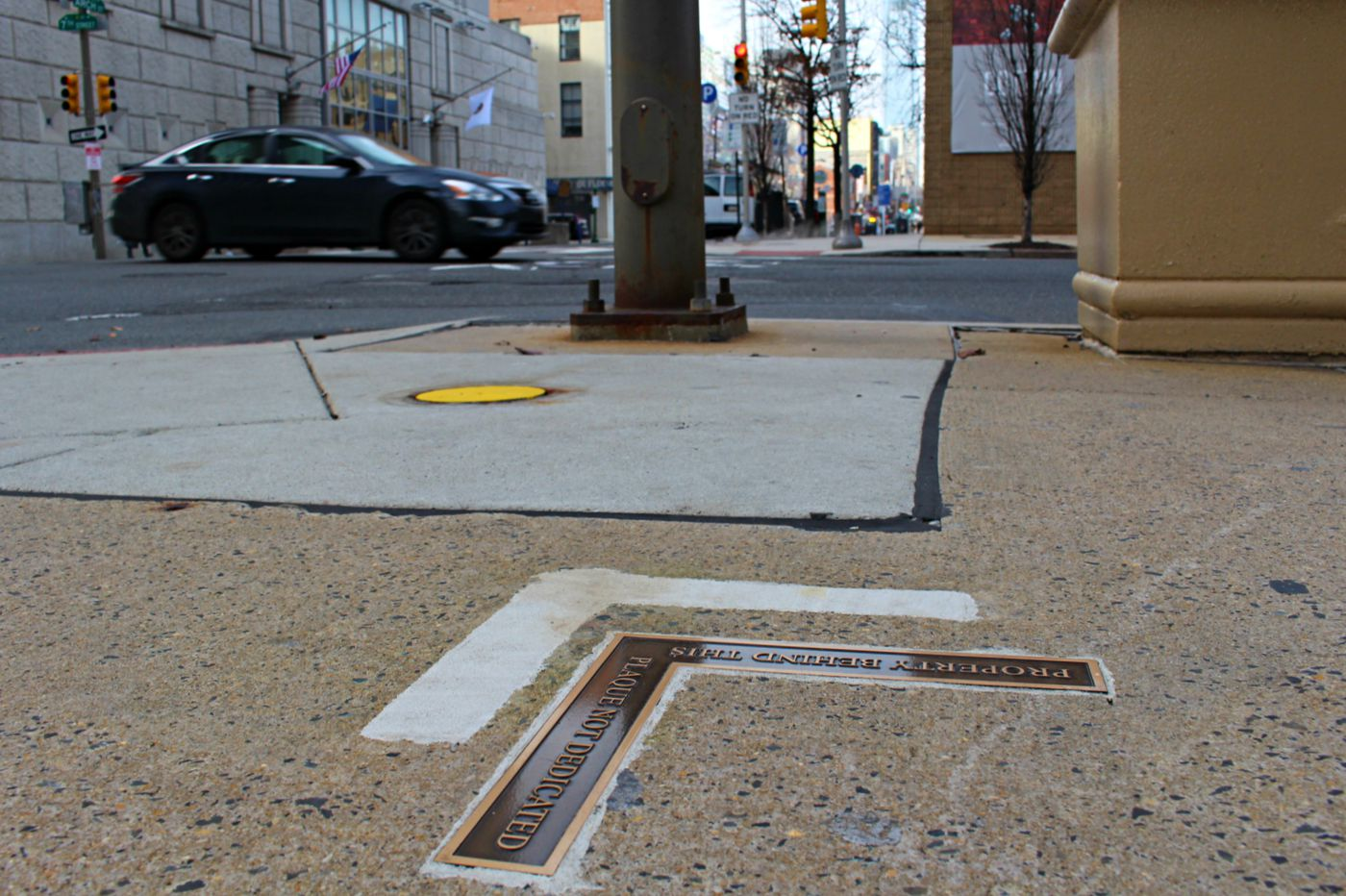 Some Philly sidewalks say they're 'not dedicated to the public.' Here's why.