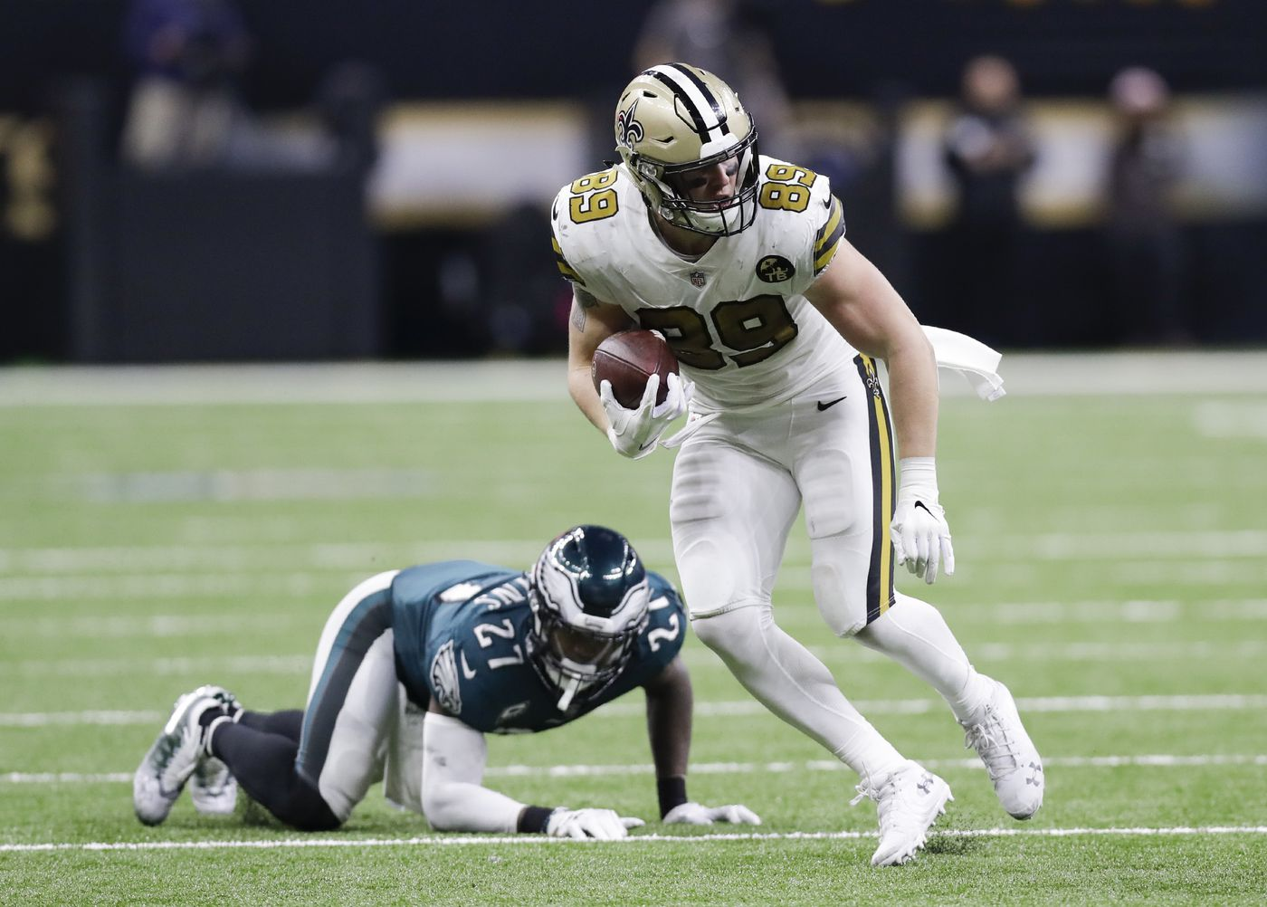 New Orleans Saints tight end Josh Hill runs with the football past Eagles  strong safety Malcolm 6367928e9