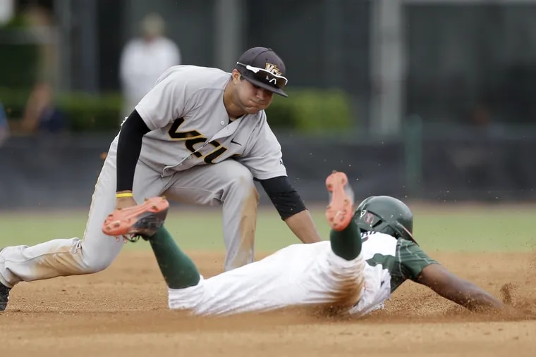 Vimael Machin, then with Virginia Commonwealth, tagging out a Miami runner during the 2015 NCAA Tournament.