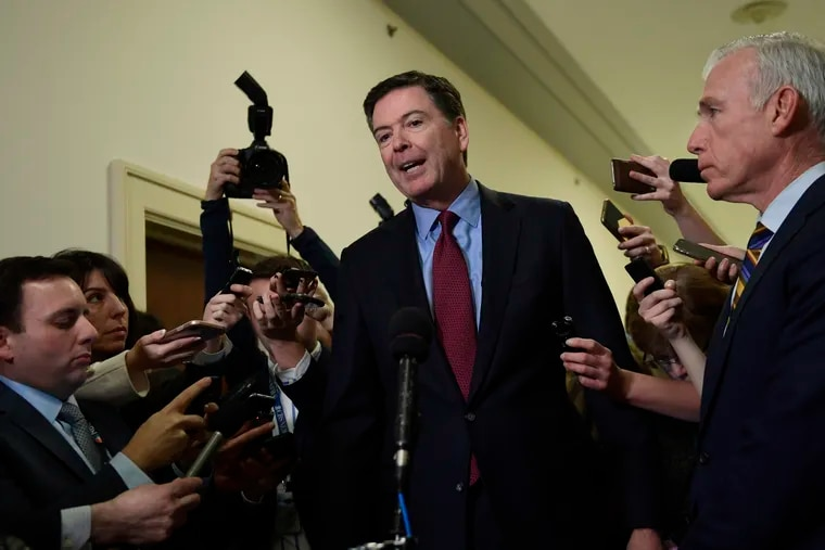 Former FBI Director James Comey, center, standing with his attornery David Kelley, right, speaks to reporters on Capitol Hill in Washington, Friday, Dec. 7, 2018, following his appearance before a closed-door hearing with the House Judiciary and House Oversight committees. (AP Photo/Susan Walsh)