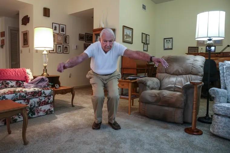 Clarence Brockman, 96, does 30 seconds of squats and 30 seconds of pushups every morning.  He follows an exercise program created by his doctor, Christopher Sciamanna, to make older patients stronger.