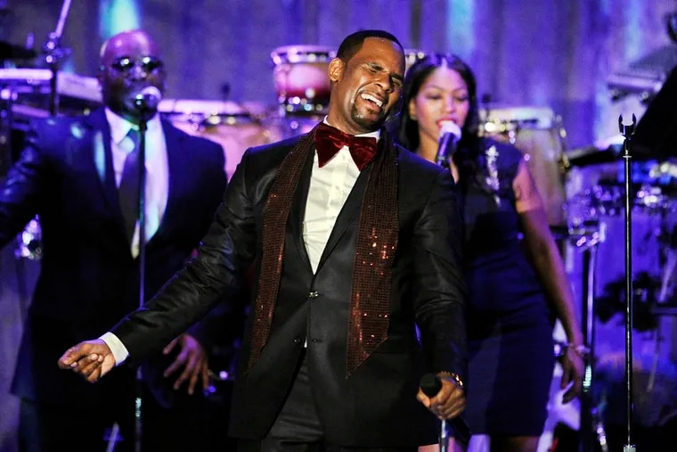 FILE - This Feb. 12, 2011 file photo shows R. Kelly performing at the pre-Grammy gala & salute to industry icons with Clive Davis honoring David Geffen in Beverly Hills, Calif. Kelly, one of the top-selling recording artists of all time, has been hounded for years by allegations of sexual misconduct involving women and underage girls — accusations he and his attorneys have long denied.