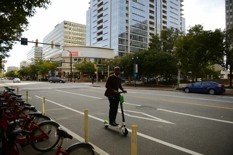 A man on a scooter along the 1900 block of Crystal Drive in Arlington, Virginia, on Oct. 19.