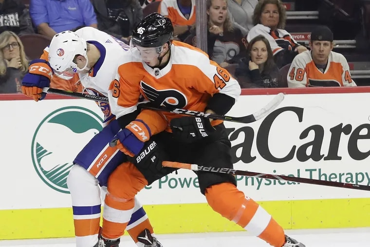 Flyers rookie Mikhail Vorobyev (right), shown battling the Islanders' Devon Toews for a loose puck in Monday's exhibition game, has had an excellent training camp and could earn a roster spot.