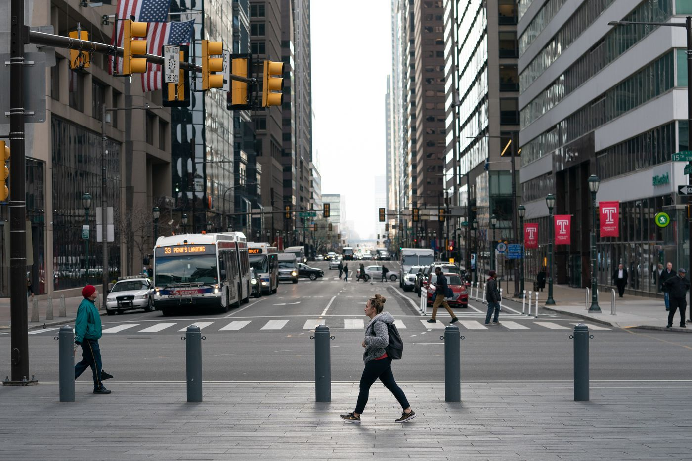 A pedestrian walks past Market Street in Dilworth Plaza along 15th Street at around 5:30pm in Philadelphia, March 17, 2020, on the first day of the shutdown of non-essential businesses. The coronavirus has been spreading across the globe since January, and now has been identified in the Philadelphia region.