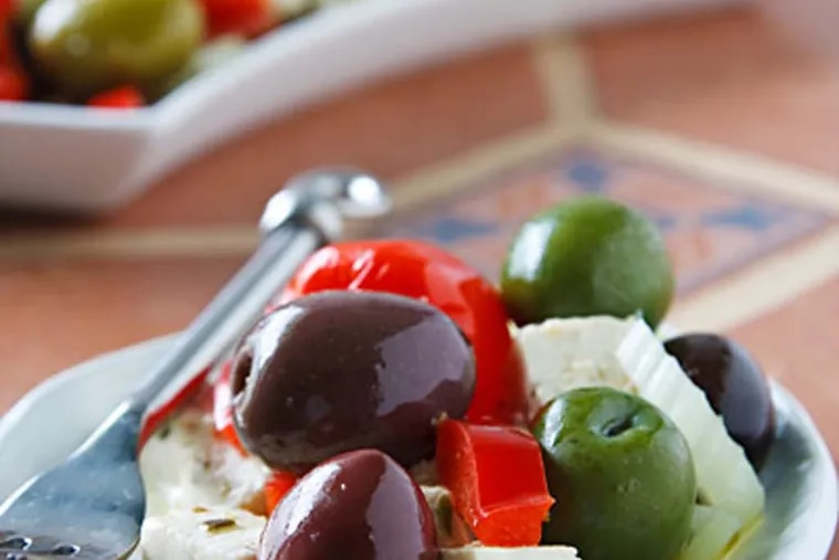 """Olive Bar Medley with Tofu """"Feta"""" as featured in Vegan Holiday Kitchen by Nava Atlas. Nava adds that this appetizer is delicious served with fresh whole grain bread and organic (vegan) white wine. (Photo: Susan Voisin)"""