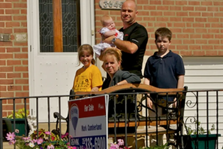 Micki Rice and her family may be headed for suburbia because of the uncertain financial status of city schools. She is accompanied by her family (from left) Starr, 10; Derrick, 12; and husband Bill Rice holding daughter Katerina.