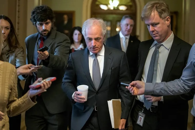 Sen. Bob Corker (R., Tenn.) is pursued by reporters Friday as Republican senators gather to meet with Senate Majority Leader Mitch McConnell (R., Ky.) on the GOP effort to overhaul the tax code.