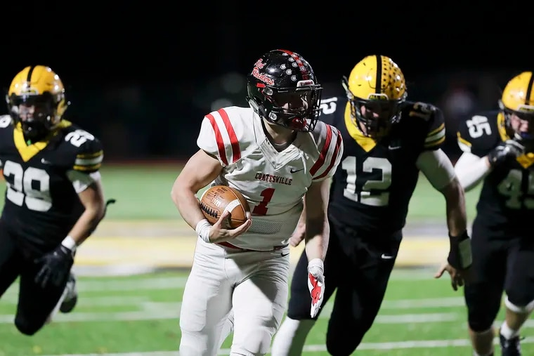 Coatesville senior quarterback Ricky Ortega, here running for a score in the District 1 playoffs against Central Bucks West, was one of several signal callers who led their teams as both rushers and passers.