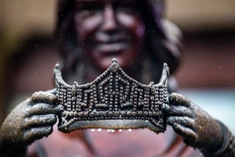 Raindrops formed on the crown of the Miss America Crowns You statue during a rainy winter day, Tuesday, Jan. 26, 2021, on the Atlantic City Boardwalk.