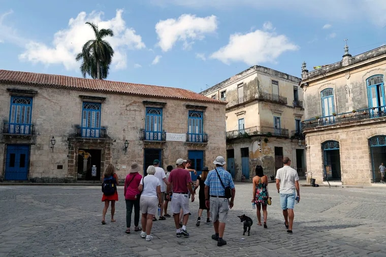 A group of American tourists on a guided tour visit Old Havana, Cuba.