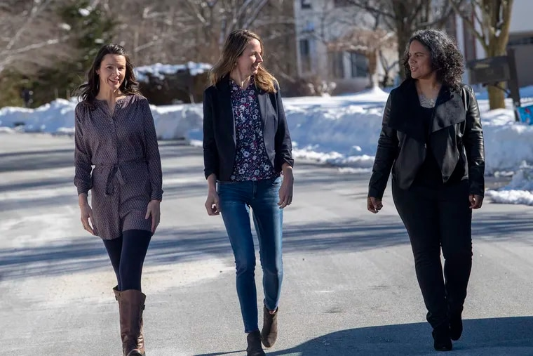Melinda McCann, center, pose for a photo with her sister, Mary Brady, left, and her cousin, Alicia Karr near her home in Exton, Pa. Thursday, February 4, 2021. Melinda, her sister, and her cousin have formed a group that is helping people find appointments for covid-19 vaccination. What started as a project to help their family has turned into a service for strangers who are challenged by the state's complicated navigation system.