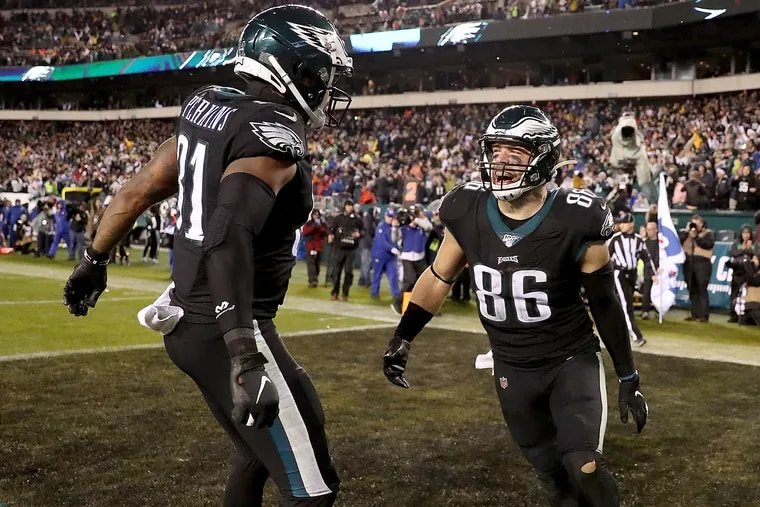 Zach Ertz (right) and Josh Perkins (left) celebrate after Ertz scored the game-winning touchdown for the Eagles against the Giants.